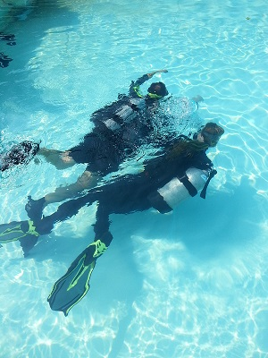 Mark and Emmy Scuba Diving under water simulating a blind diver